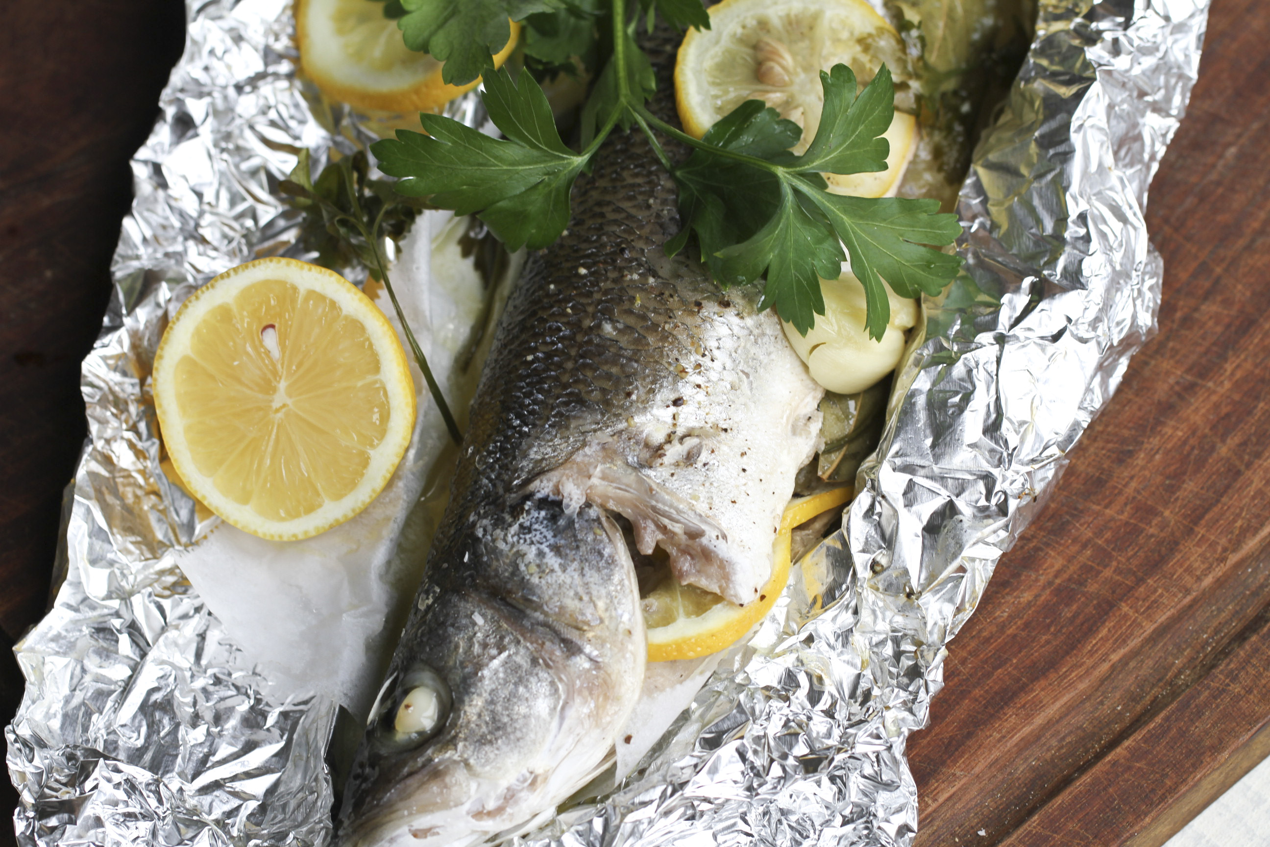 whole fish baked in a foil parcel ever open sauce
